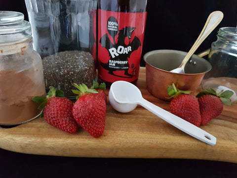 Cocoa, chia seed pudding with fresh strawberries and raspberry jam cordial Roar Living. Clean, easy dessert. Additive free, preservative free.