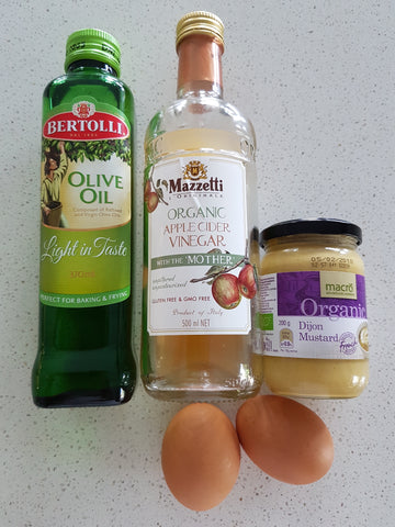 easy, simple mayonnaise recipe Ingredients for mayonnaise. Eggs, olive oil, mustard, maple cider vinegar.