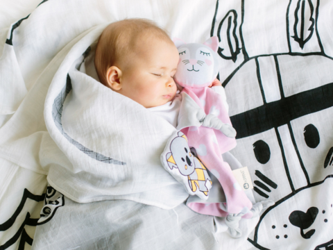 Baby sleeping on organic cotton muslin wrap