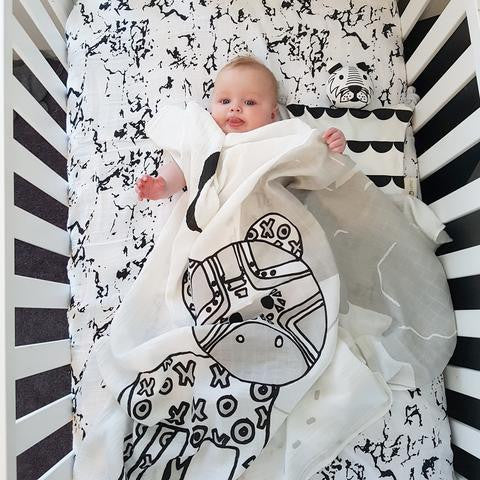 Baby in Dash Kippin muslin wrap