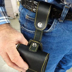 Holster style phone case showing case being attached to belt strap