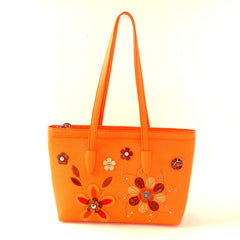 pale orange leather tote bag with flower detail
