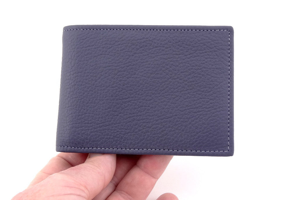 Grey leather small men's wallet held in hand