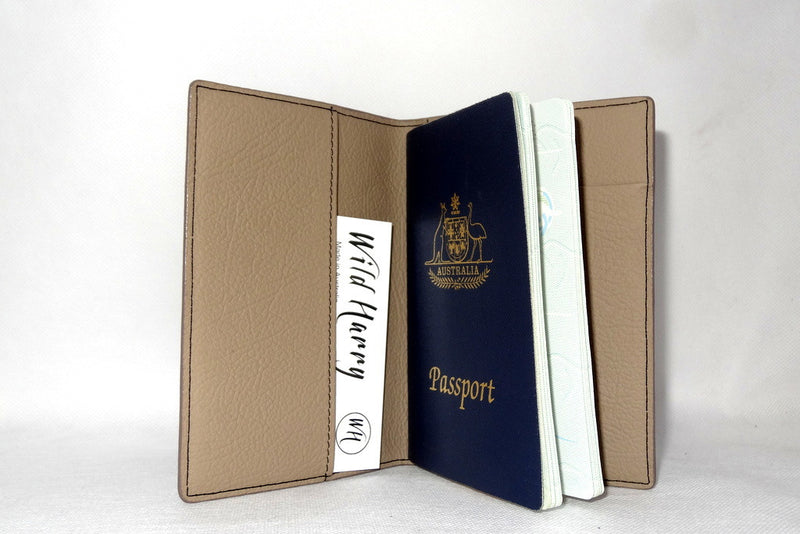 Passport Holder - Black leather with cream lining inside side 1