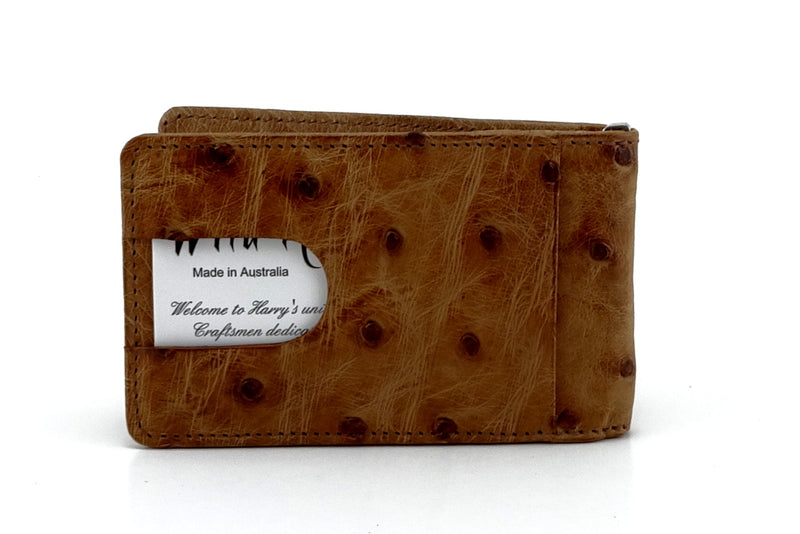 Ostrich tan bill fold showing back view business card in thumb pocket