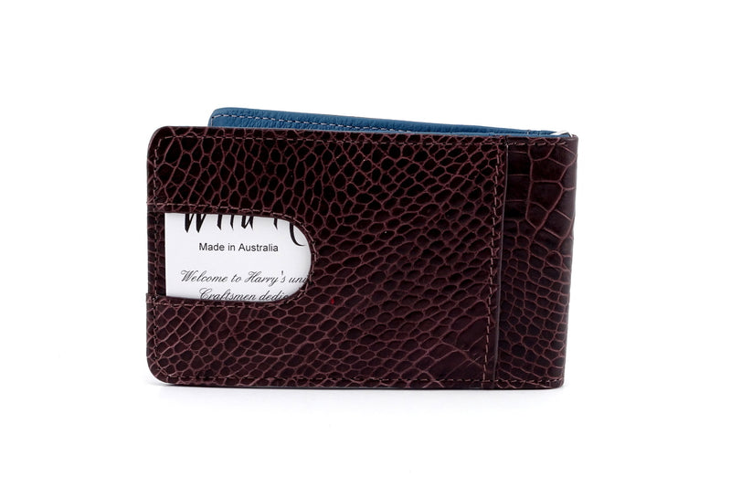Bill fold back view crocodile print leather showing thumb pocket with business card in use
