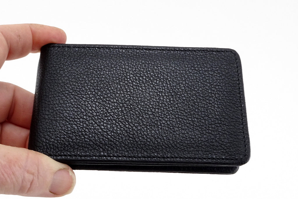 Bill fold wallet outside view black leather held in hand to show size