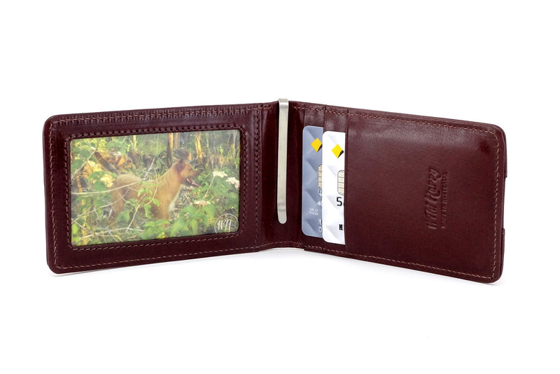 Tan leather bill fold wallet inside pockets in use