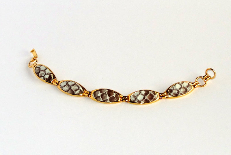 Gold plated bracelet in brown and white sea snake