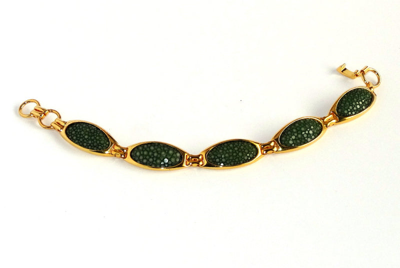Bracelet gold palated green beady ray skin used