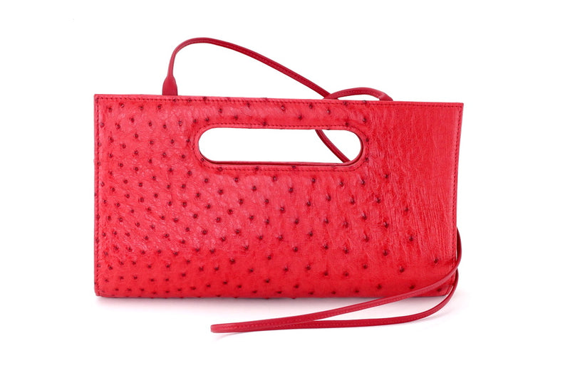 Susan red ostrich skin evening clutch bag with shoulder strap attached front view