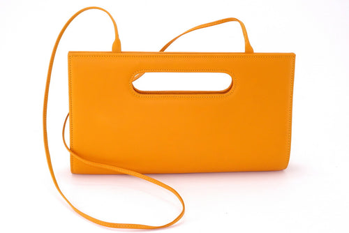 Susan Mango clutch evening bag with shoulder strap attached front view