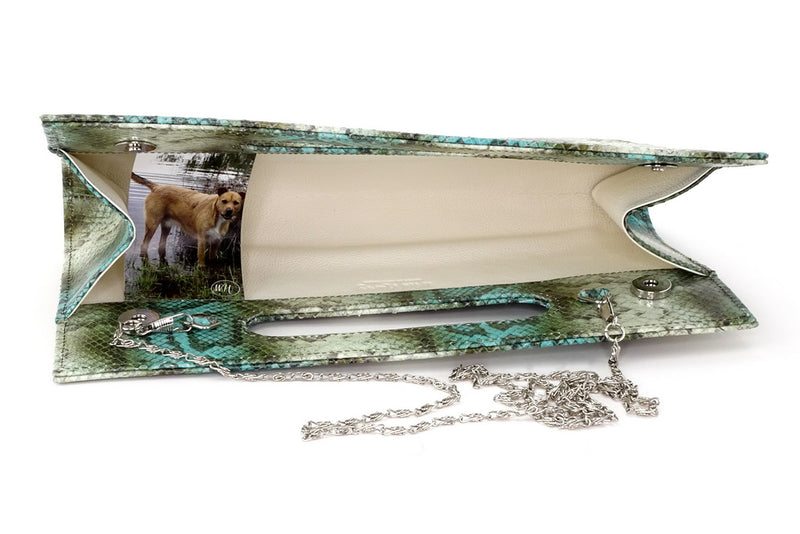 Susan snake printed leather olive & blue evening clutch bag showing chain shoulder strap attached inside view