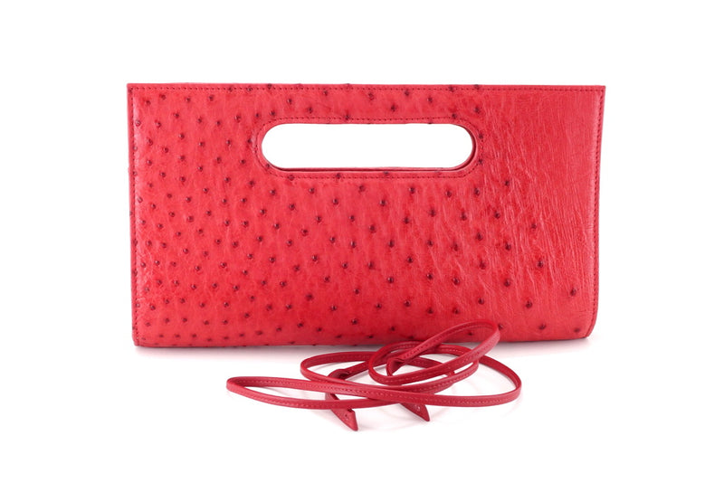 Susan red ostrich skin evening clutch bag with shoulder strap removed front view