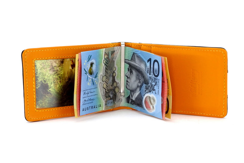 Bill fold - Daryle - Black leather with mango leather lining small men's wallet showing money clip with notes in use