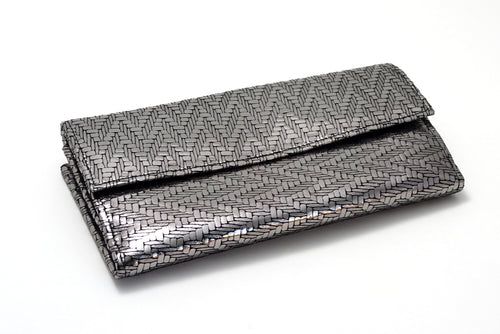 Lyla  Silver zig zag metallic leather ladies clutch purse front laying flat