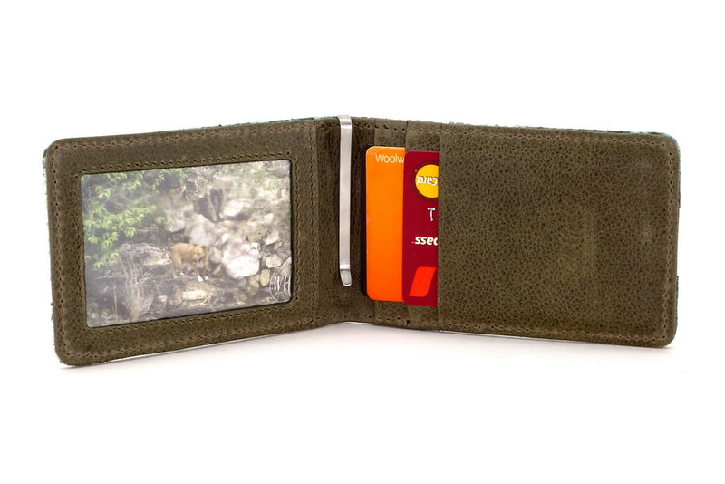 Bill fold - Daryle - Blue & olive printed leather man's small wallet showing picture in picture window, cards in pockets and money clip in middle