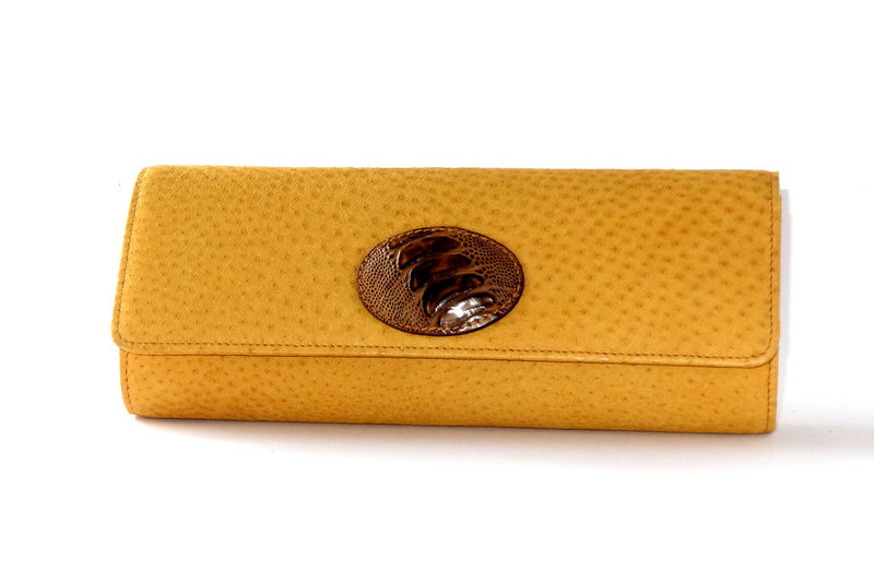 Meredith  Yellow emu with emu leg button detail ladies clutch bag front