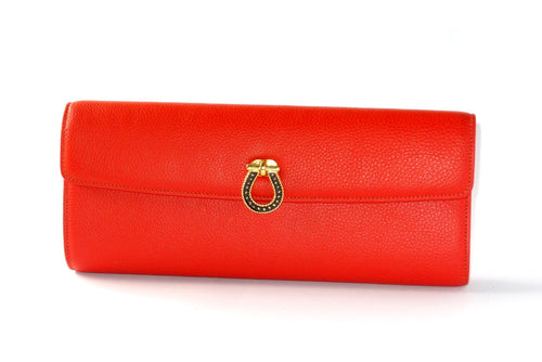 Kate  Orange leather with reversible clasp ladies clutch bag front