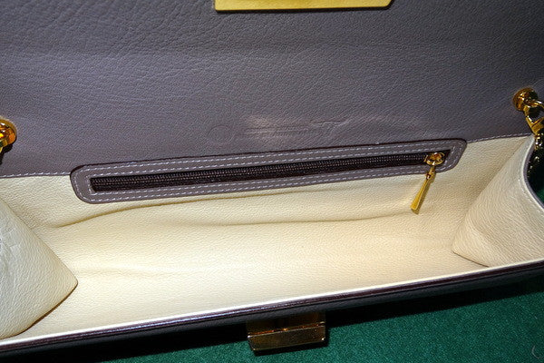 Meredith  Grape leather oversized clasp ladies clutch bag inside