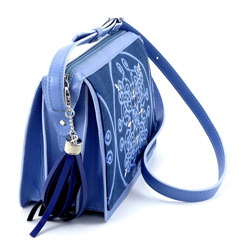 Riley Cross body bag denim fabric & astral blue leather tassel end view