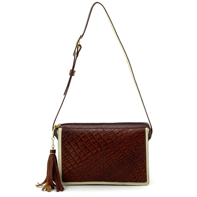 Riley Cross body bag cream with brown corocodile printed leather showing shoulder strap drop