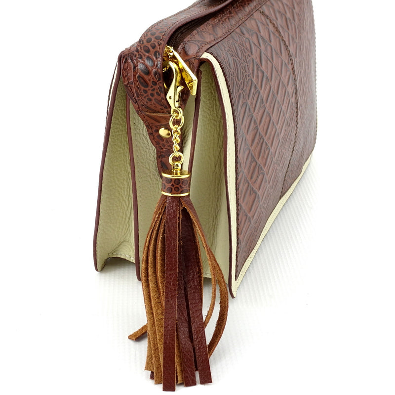Riley Cross body bag cream with brown corocodile printed leather showing tassel feature