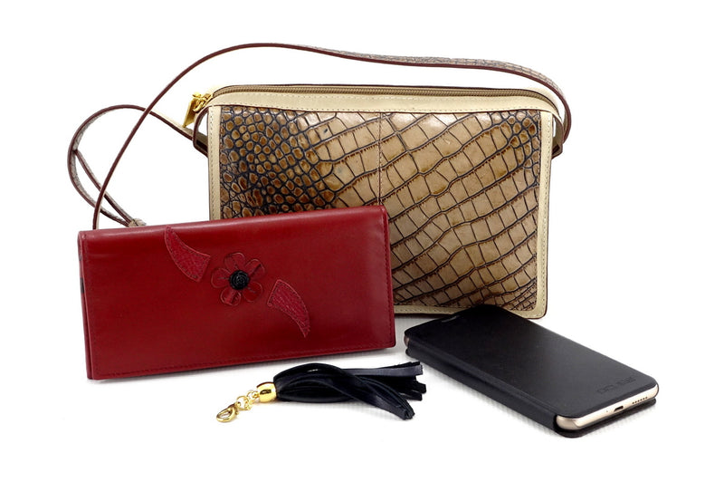 Riley Cross body bag off white with grey crocodile printed leather showing Caitlin purse, smart phone & detachable tassel