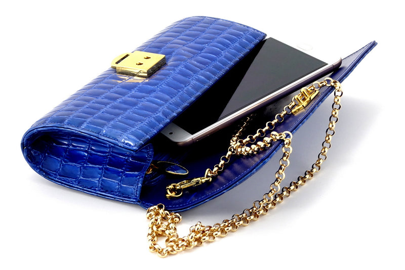 Leah  Blue foil coated leather ladies clutch bag showing smart phone