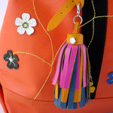 Felicity  Orange leather webbing straps & flowers large tote bag tassel detail