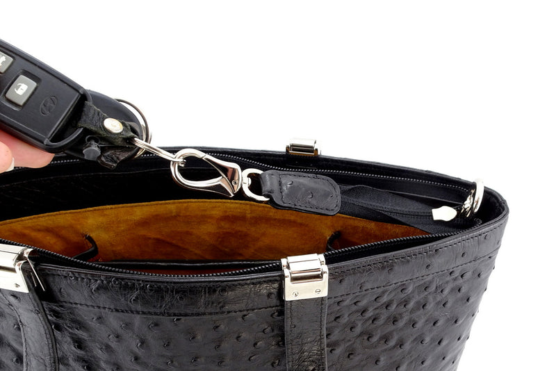 Black ostrich tote bag with nickel fittings outside view showing how keys attach to inside key holder