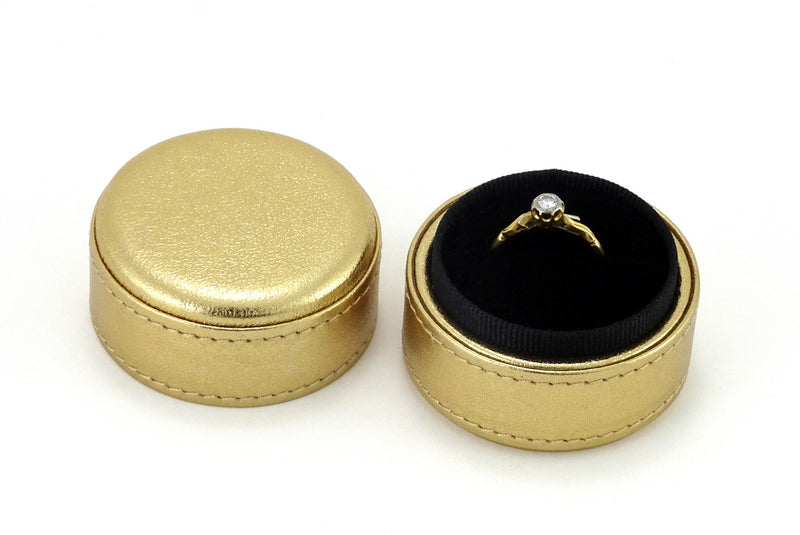 Ring Box round  Gold metallic sheep skin leather lid off shown with ring