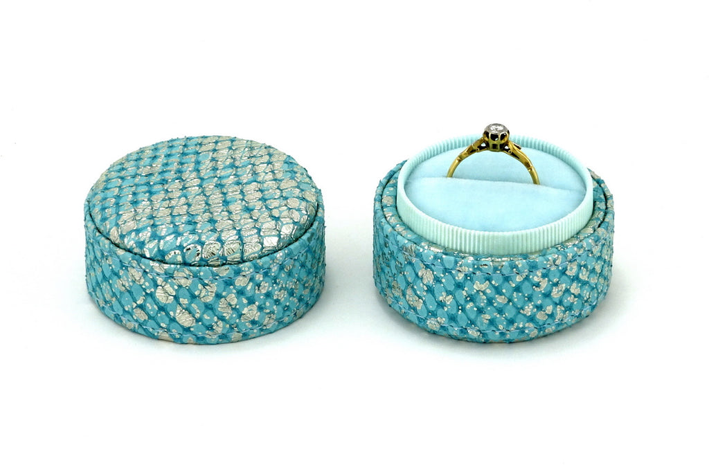Ring Box round  Mermain blue metallic textured leather lid off showing ring