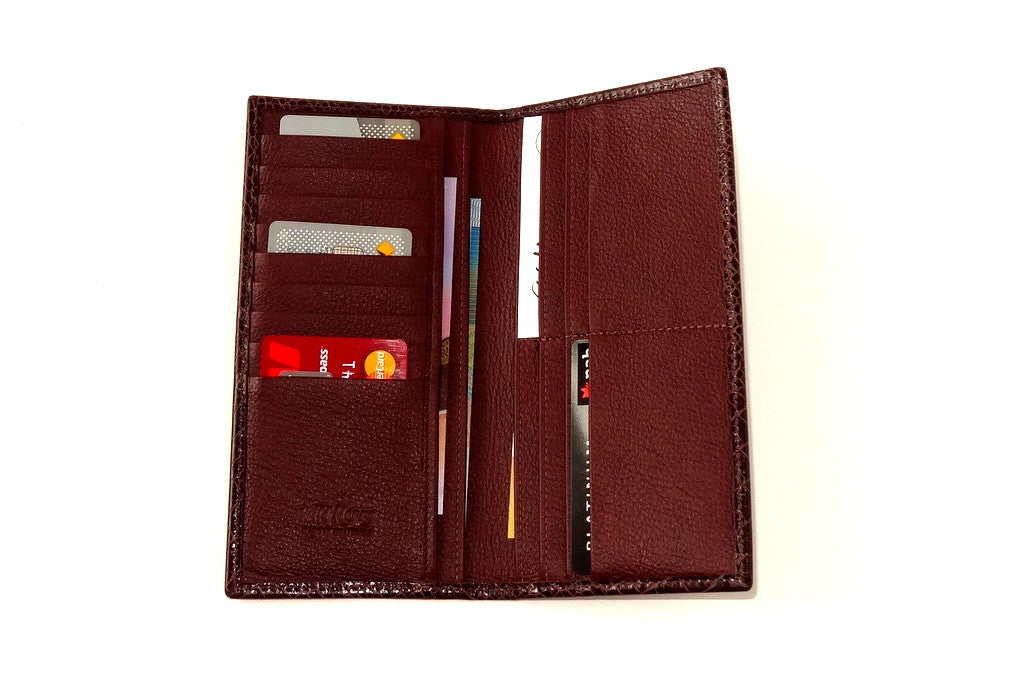Inside of suit wallet with cards and money showing how the wallet works