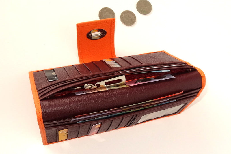 Molly  Pale Orange textured leather ladies clutch purse showing coin section in use
