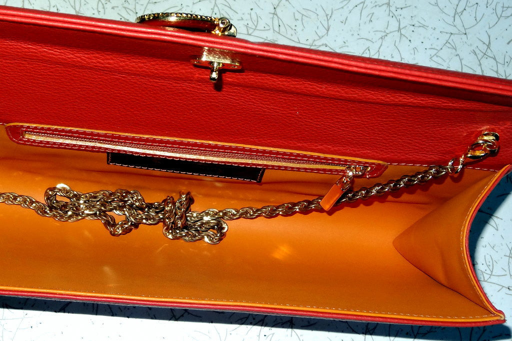Kate  Orange leather with reversible clasp ladies clutch bag inside