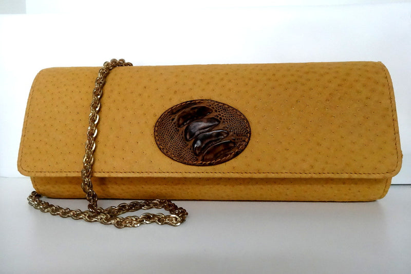 Meredith  Yellow emu with emu leg button detail ladies clutch bag front with chain