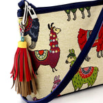 Rosie Llama printed fabric leather lined small tote bag featuring the tassel