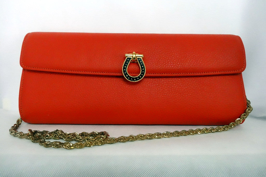Kate  Orange leather with reversible clasp ladies clutch bag front clasp reversed