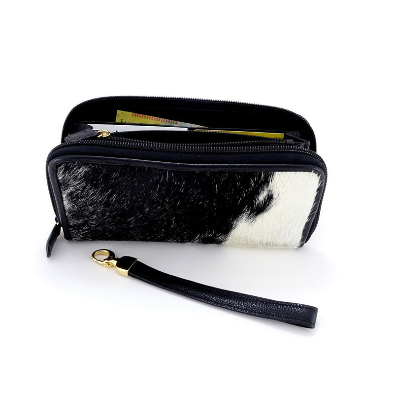 Victoria  Black & white hair on cowhide ladies zip around purse side view zip open