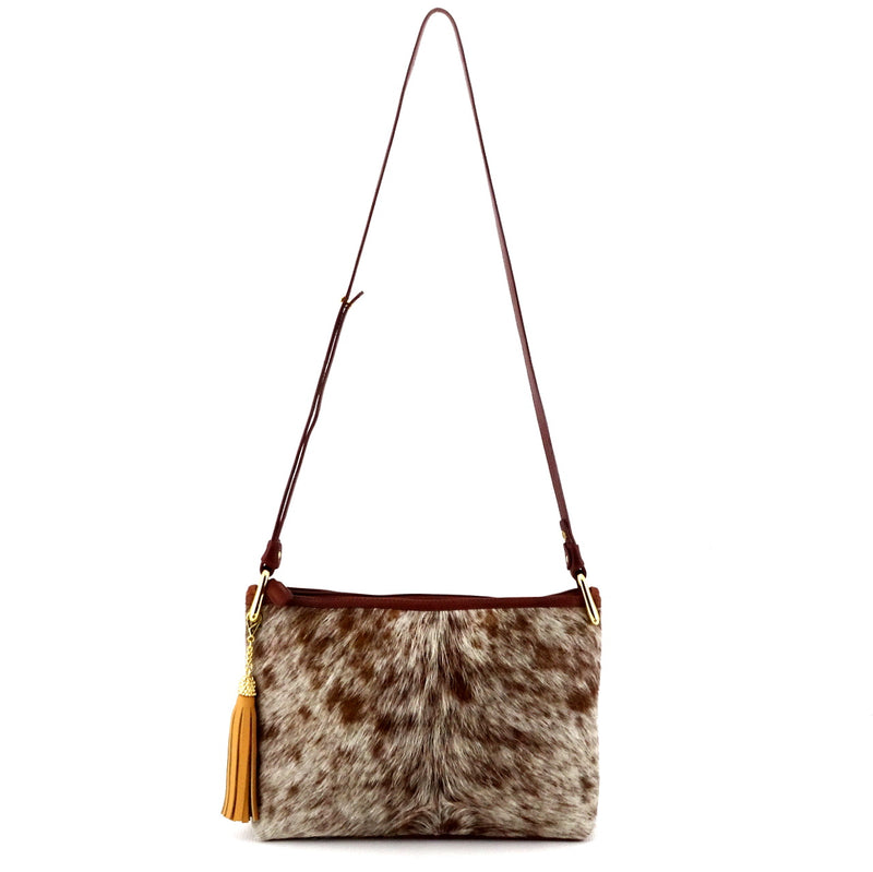 Rosie brown flecked hair on hide rust leather small tote bag showing shoulder strap drop