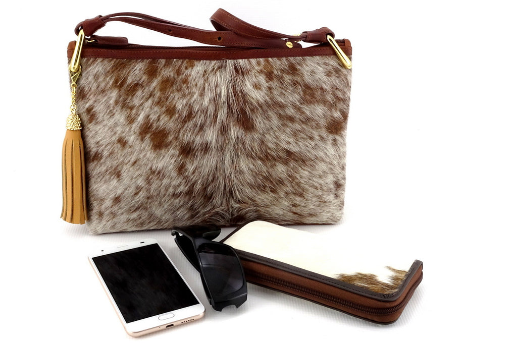 Rosie brown flecked hair on hide rust leather small tote bag showing phone, purse, sunglasses