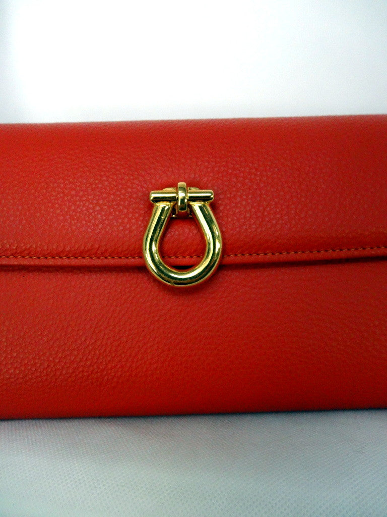 Kate  Orange leather with reversible clasp ladies clutch bag clasp gold side up