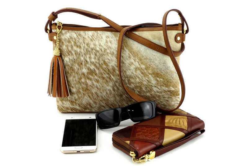 Rosie brown & cream flecked hair on hide tan leather small tote bag showing sunglasses, Michaela purse & smart phone