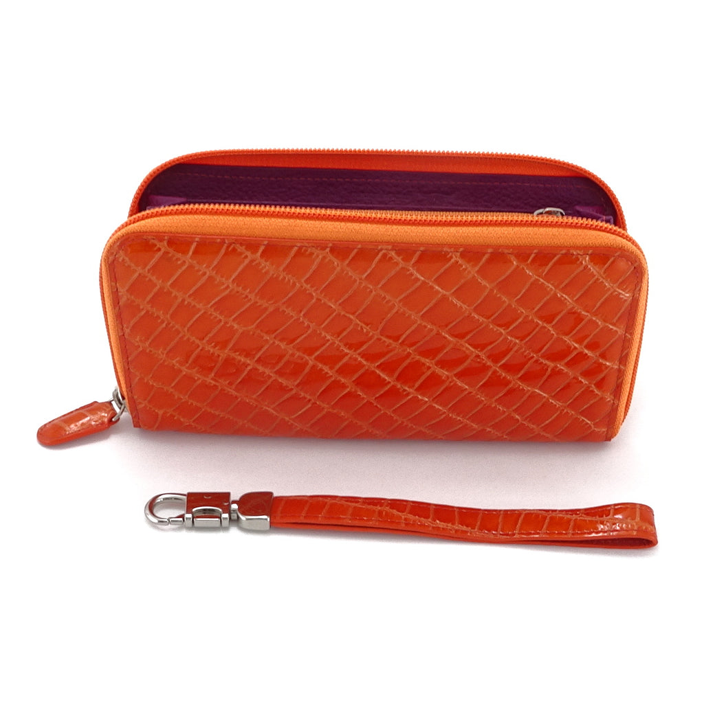 Victoria  Orange foil leather purple internal ladies zip around purse side view from top zip open