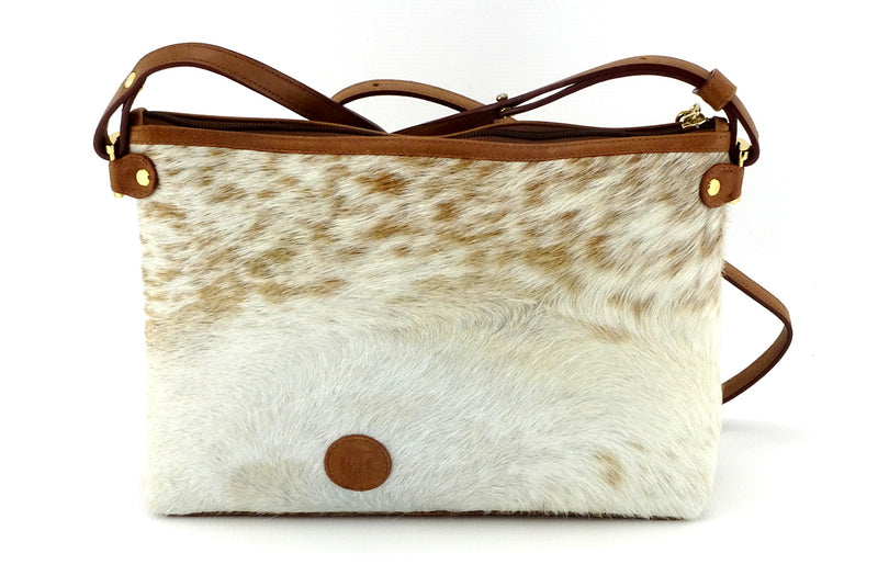 Rosie brown & cream flecked hair on hide tan leather small tote bag showing back side with logo