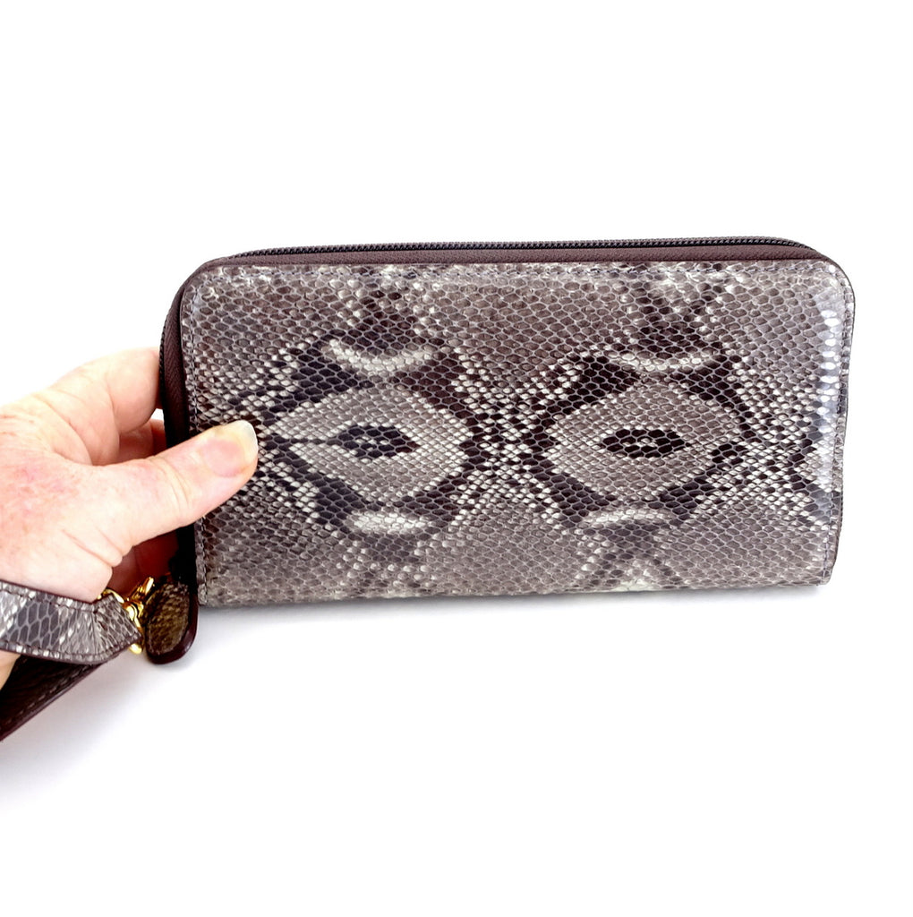 Victoria  Grey snake print leather gold ladies zip around purse hand holding the purse