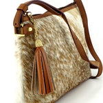 Rosie brown & cream flecked hair on hide tan leather small tote bag showing tassel end