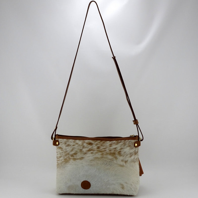 Rosie brown & cream flecked hair on hide tan leather small tote bag showing shoulder strap drop side 2 with logo