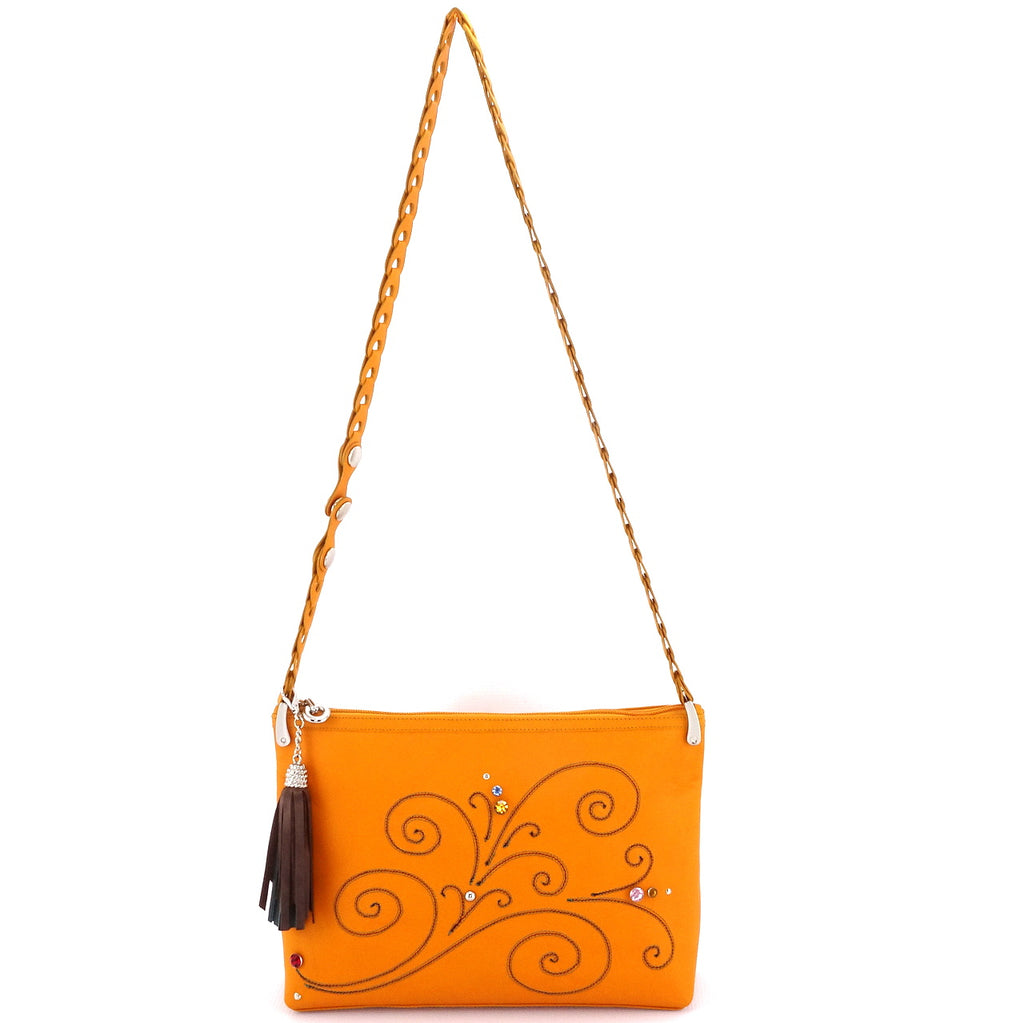 Rosie Mustard leather stitched swirl details small tote bag showing shoulder strap extended